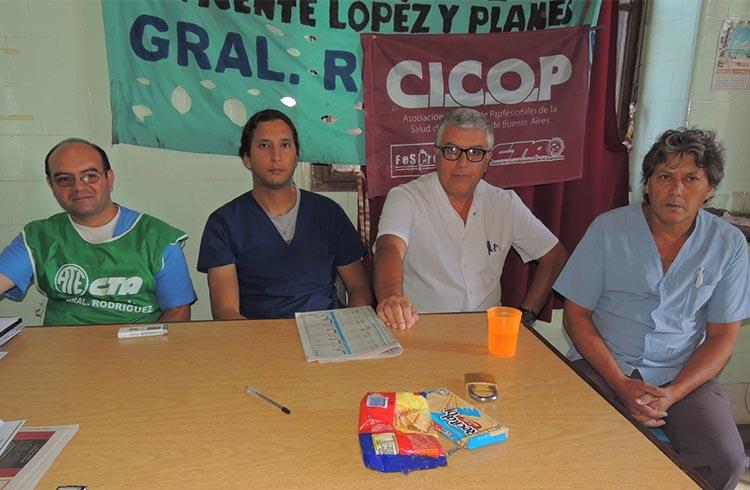 (Representantes gremiales de ATE y CICOP durante la conferencia de prensa)